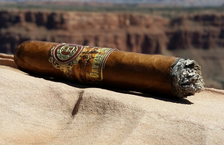 Cattle Baron Cigar on a rock
